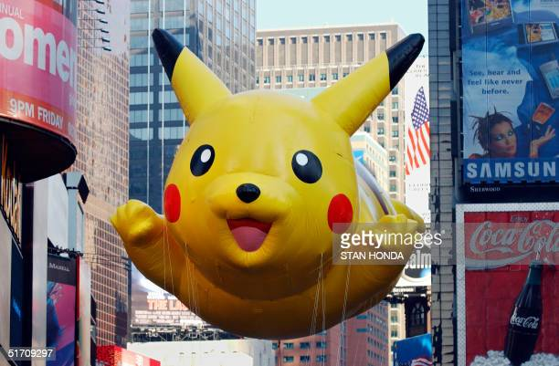 The 'Pikachu' balloon sponsored by The Pokemon Company floats down Broadway during the 75th Macy's Thanksgiving Day Parade 22 November 2001 in New...