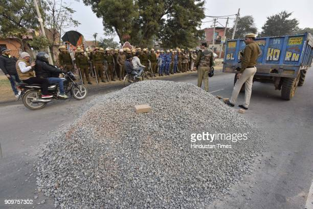 The pile of gravel dumped on road in order to block the traffic near village Bhondsi in Gurgaon allegedly by activists of Karni Sena who were...