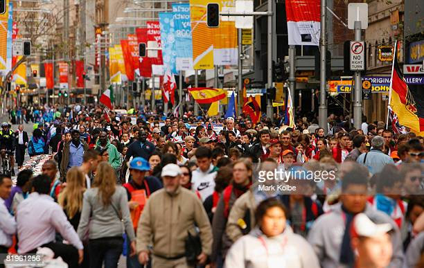 The Pilgrim Crowd walk down George street ahead of the Papal Welcome Ceremony for The Holy Father Pope Benedict XVI at Barangaroo Wharf at Barangaroo...