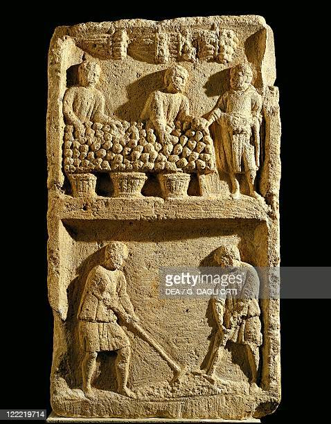The Pillar of the Farmer relief depicting a fruit market and two farmers tilling the soil
