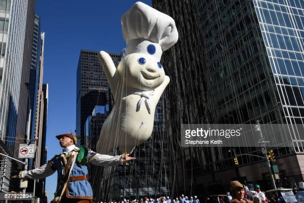 The Pillsbury Doughboy balloon floats on 6th Ave during the annual Macy's Thanksgiving Day parade on November 23 2017 in New York City The Macy's...