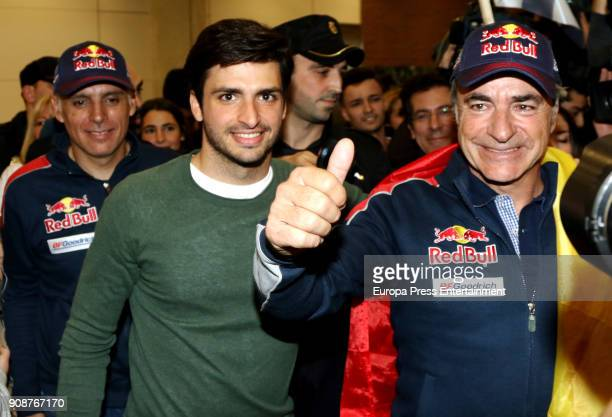 The pilot Carlos Sainz winner of 2018 Dakar Rally acompannied by his son Carlos Sainz jr arrive at Madrid aiport on January 22 2018 in Madrid Spain