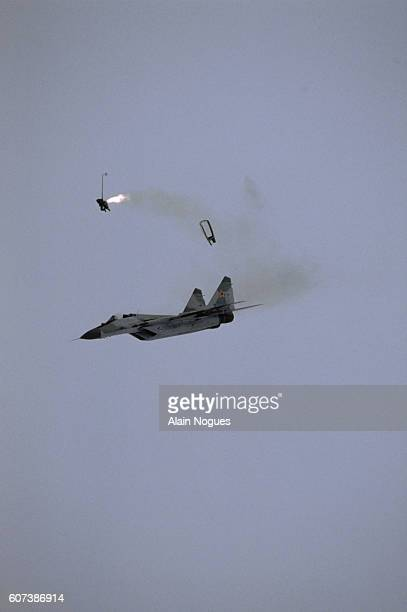 The pilot of a Russian MiG29 aircraft ejects from the plane when he realizes that it is about to crash at the 1989 Paris Air Show Though the aircraft...