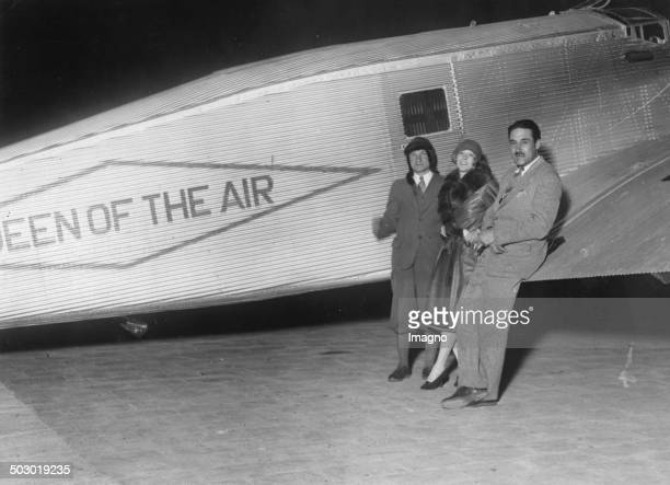 The pilots Charles A Levine and Mabel Boll and Bert Acosta at the Le Bourget airport with her Junker aircraft The Queen of the Air 1928 Photograph