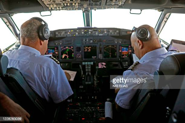 The pilots of the El Al's airliner, which is carrying a US-Israeli delegation to the UAE following a normalisation accord, check their papers as they...