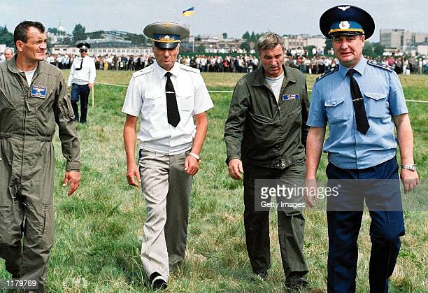 The pilots of the Su-27 fighter plane which crashed into a crowd of spectators during an air show, Vladimir Toponar and Yuri Yegorov walk with...