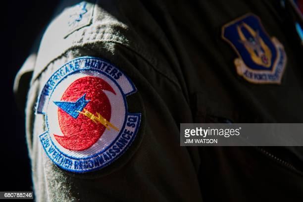 """The pilots patch on his flight suit within a C-130 belonging to the US Air Force 53rd Weather Reconnaissance Squadron """"Hurricane Hunters"""" during the..."""