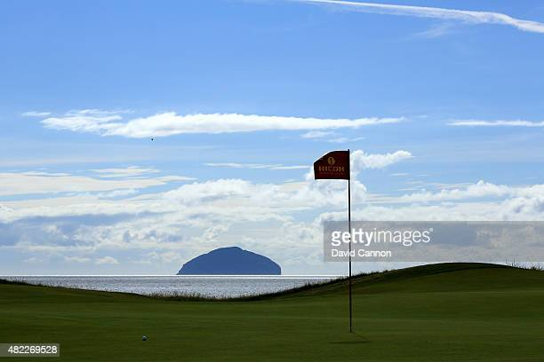 The pin flag on the eighth green flutters in the gentle breeze with the island of Ailsa Craig behind as a preview for the 2015 Ricoh Women's British...