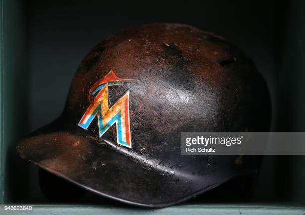 The Pine Tar incrusted batting helmet of Justin Bour of the Miami Marlins sits in the dugout before a game against the Philadelphia Phillies at...