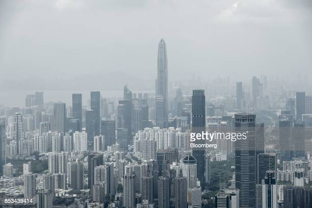 The Ping An International Finance Center center stands among commercial and residential buildings in Shenzhen China on Wednesday Sept 20 2017 China...