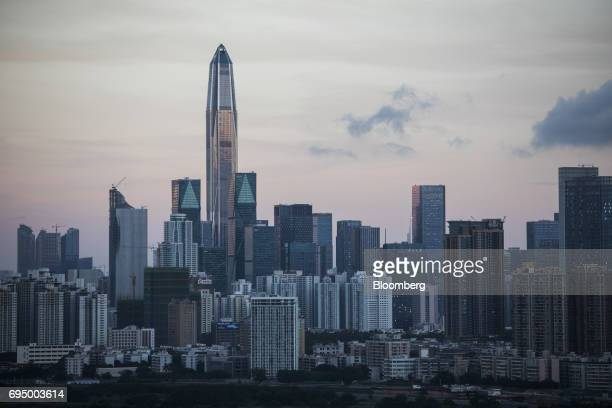 The Ping An International Finance Center centre left and other buildings at dawn in Shenzhen are seen from the Ma Tso Lung district of Hong Kong...