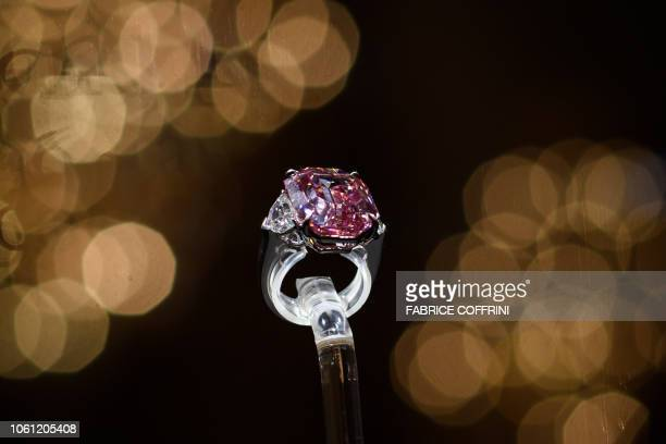 The Pink Legacy a 1896 carat fancy vivid pink diamond once owned by the Oppenheimer family is seen after its sale at Christie's auction house on...