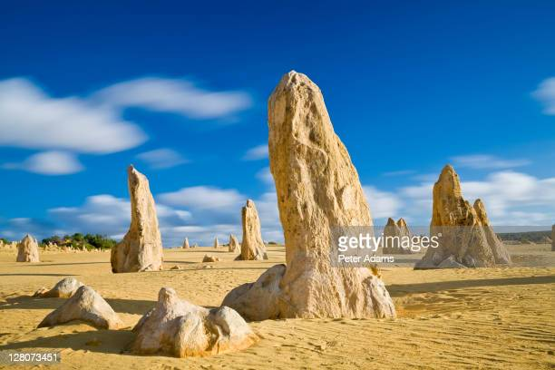 the pinnacles, limestone pillars which tower out of the flat, sandy desert, nambung national park, western australia - peter adams stock pictures, royalty-free photos & images
