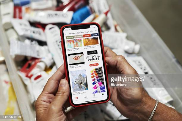 The Pinterest Inc application is displayed on an Apple Inc iPhone in this arranged photograph taken in Little Falls New Jersey US on Saturday Feb 23...