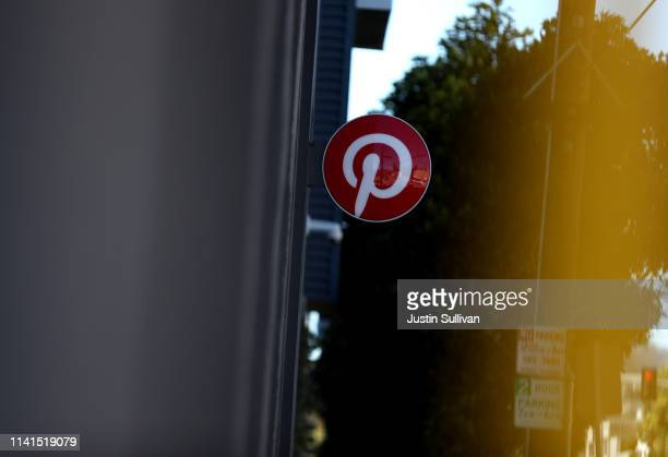 The Pinterest logo is displayed at the headquarters on April 09 2019 in San Francisco California Social sharing site Pinterest is preparing for its...