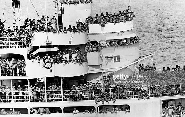 The Pioneer Commander, a US ship carries thousands of Vietnamese soldiers who had hijacked the vessel from Da Nang in front of the advancing...
