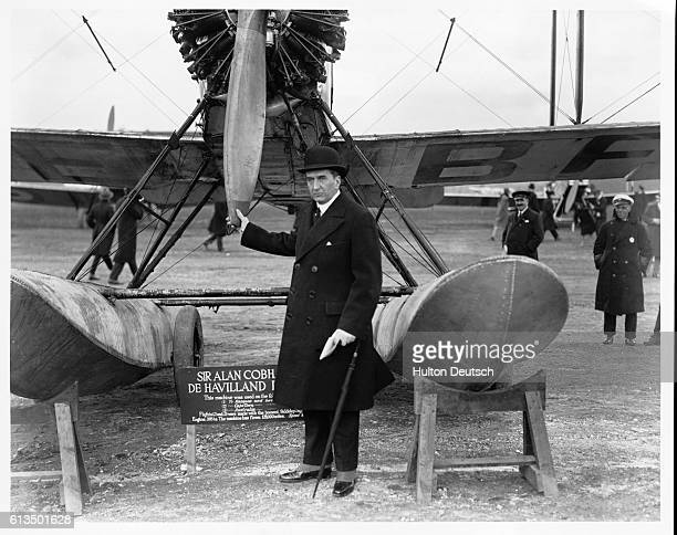 The pioneering British aviator Sir Alan Cobham stands beside a propeller aircraft possibly a De Havilland 1953