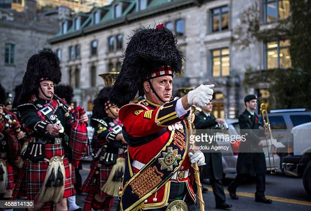 The pipes and drums of the 1st Battalion The Royal Canadian Regiment march onto the parade during a Remembrance Day ceremony which marks the...