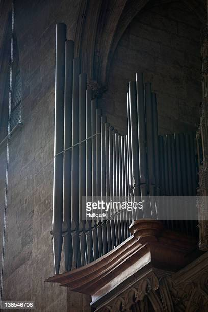 The pipes of a pipe organ in a church