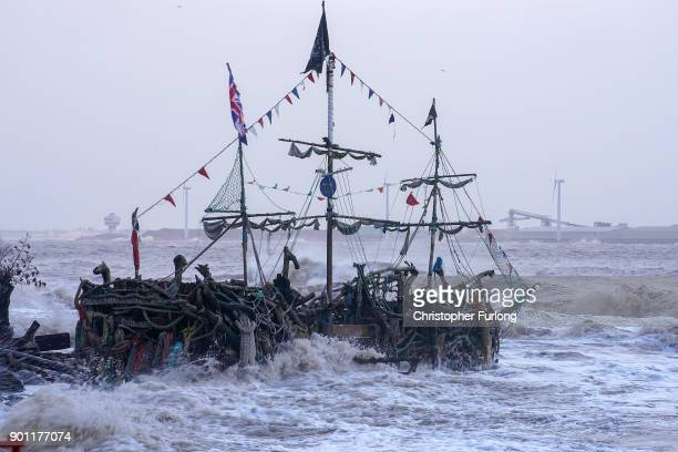 The Pirate Ship art installation made from driftwood braves the waves whipped up by the wind of Storm Eleanor lash against the sea wall on January 03...