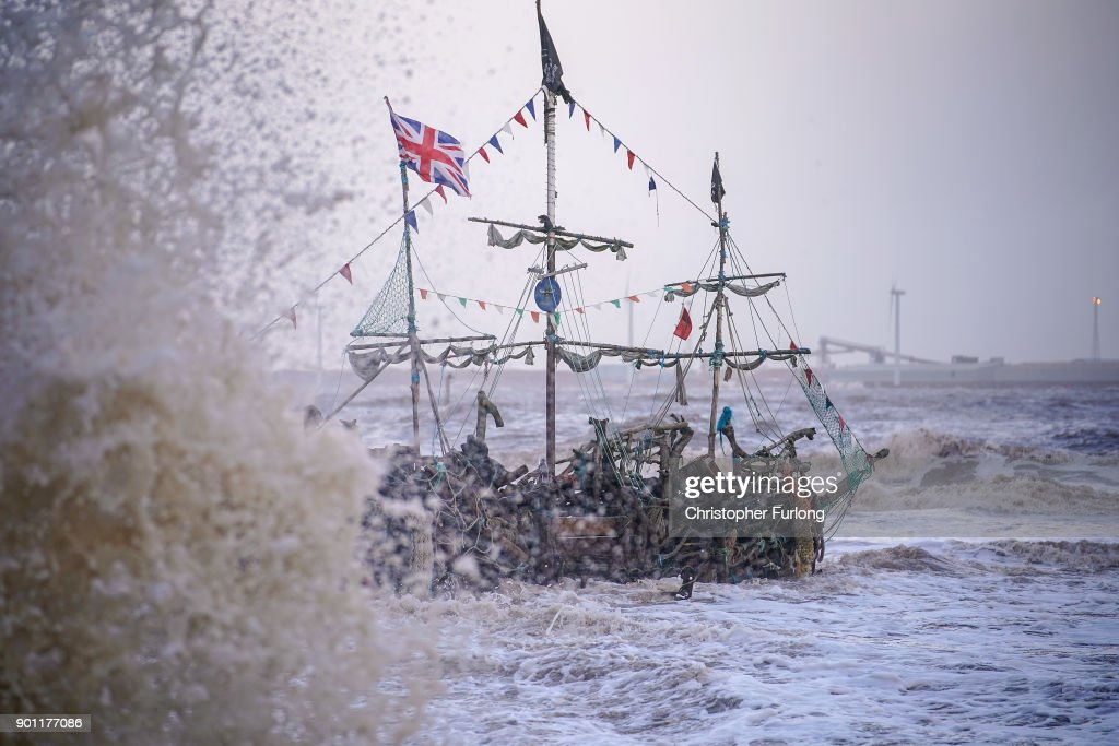 The Pirate Ship art installation, made from driftwood, braves the waves whipped up by the wind of Storm Eleanor lash against the sea wall on January 03, 2018 in New Brighton, United Kingdom. Overnight Storm Eleanor brought 70-100mph gusts and torrential rain to some parts of the UK and Ireland creating floods and cutting electricity supplies in some areas. A yellow warning by the Met Office is still in force.