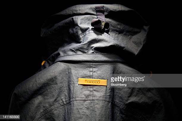 The Pirelli C SpA logo sits on a raincoat displayed for sale inside the company's store in Milan Italy on Thursday March 8 2012 Rubber advanced to a...