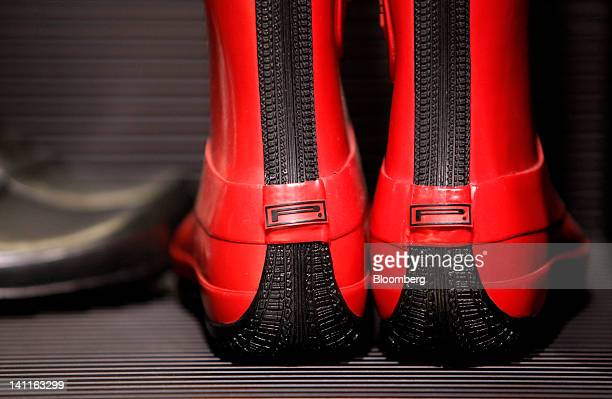 The Pirelli logo sits on the heel of rubber wellington boots inside the Pirelli C SpA store in Milan Italy on Thursday March 8 2012 Rubber advanced...