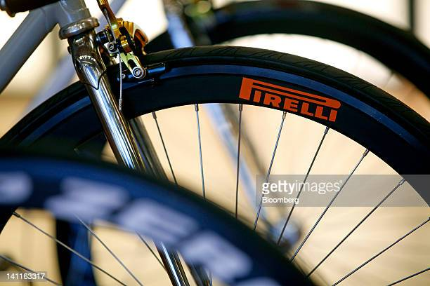 The Pirelli logo sits on the rim of a bicycle wheel inside the company's store in Milan Italy on Thursday March 8 2012 Rubber advanced to a oneweek...