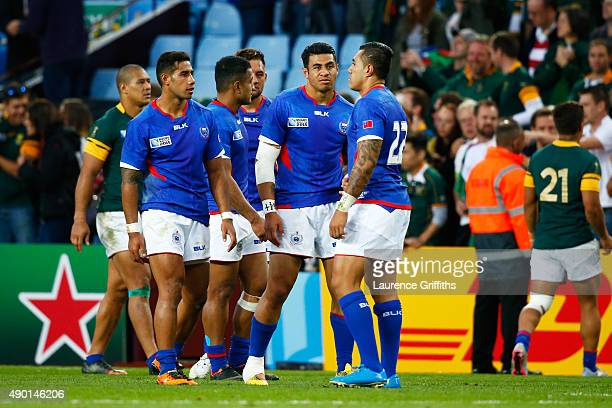 The Pisi brothers with George, Ken and Tusi look on during the 2015 Rugby World Cup Pool B match between South Africa and Samoa at Villa Park on...