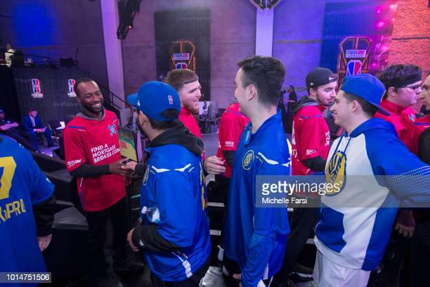 The Pistons Gaming Team give daps to the Warriors Gaming Squad after the game during Week 12 of the NBA 2K League on August 10 2018 at the NBA 2K...