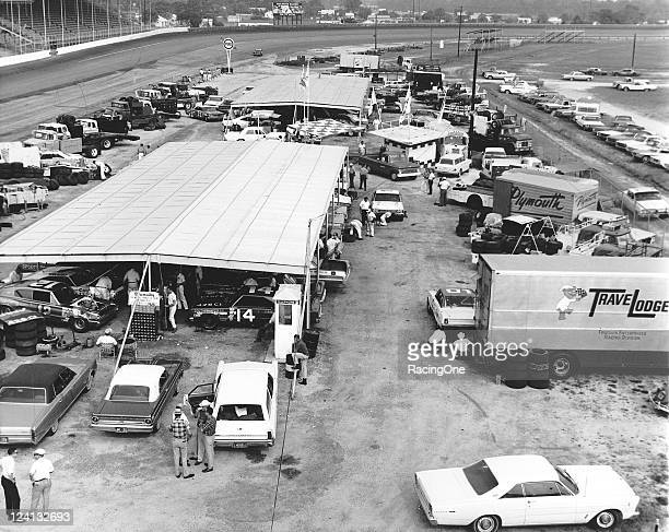 The pit area was always a crowded place at Darlington Raceway during NASCAR Cup events like this one. Among the cars seen in the foreground are...