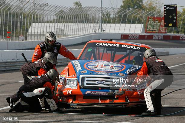 The pit crew for Rick Crawford driver of the Cirle Bar/International Truck Engine Ford work to change tires on the truck during the Camping World...