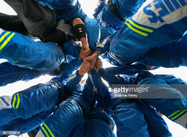 The pit crew of Jimmie Johnson driver of the Lowe's Chevrolet huddle before the Monster Energy NASCAR Cup Series FireKeepers Casino 400 at Michigan...