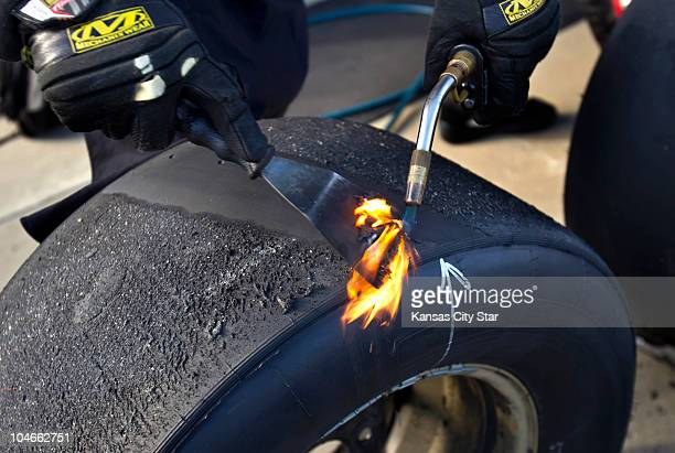 The pit crew of NASCAR Nationwide Series driver Kevin Harvick used propane torches to burn the tire shavings to take measurements on the tires...
