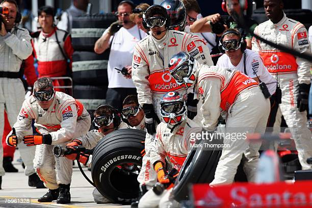 The pit crew wait for Fernando Alonso of Spain and McLaren Mercedes in the pits during the Hungarian Formula One Grand Prix Qualifying Session at the...