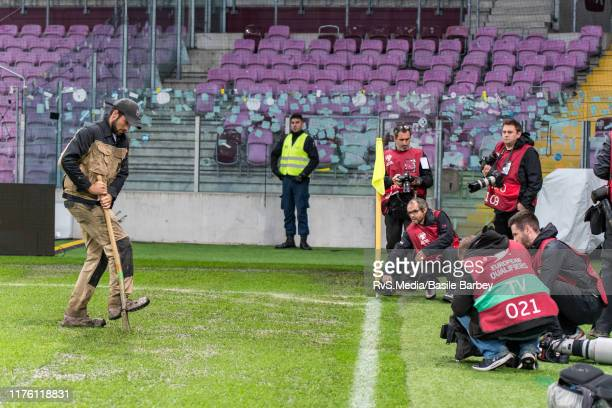 The pitch administrator prepares the pitch before Euro 2020 qualifier between Switzerland and Republic of Ireland on October 15 2019 in Geneva...