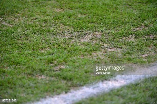 The pitch is in a poor state for the Ligue 1 match between SM Caen and Strasbourg at Stade Michel D'Ornano on March 4 2018 in Caen France