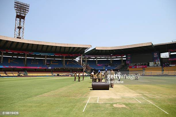 The pitch is prepared ahead of the ICC WT20 match between Australia and Bangladesh at The M Chinnaswamy Stadium on March 20 2016 in Bangalore India