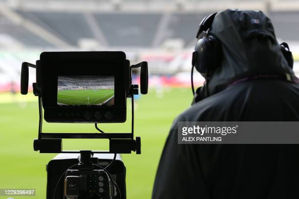 The pitch is seen through the lens of a TV camera ahead of the English Premier League football match between Newcastle United and Everton at St...