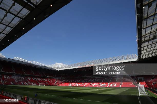 The pitch is watered ahead of the English Premier League football match between Manchester United and Crystal Palace at Old Trafford in Manchester...