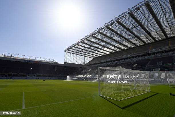 The pitch is watered ahead of the English Premier League football match between Newcastle United and Tottenham Hotspur at St James' Park in...