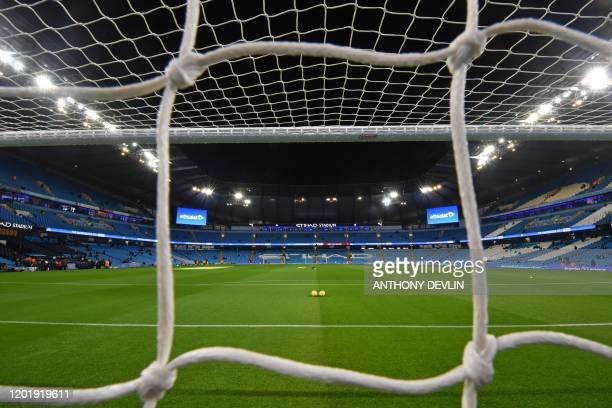 The pitch under floodlights is seen through the net ahead of the English Premier League football match between Manchester City and West Ham United at...