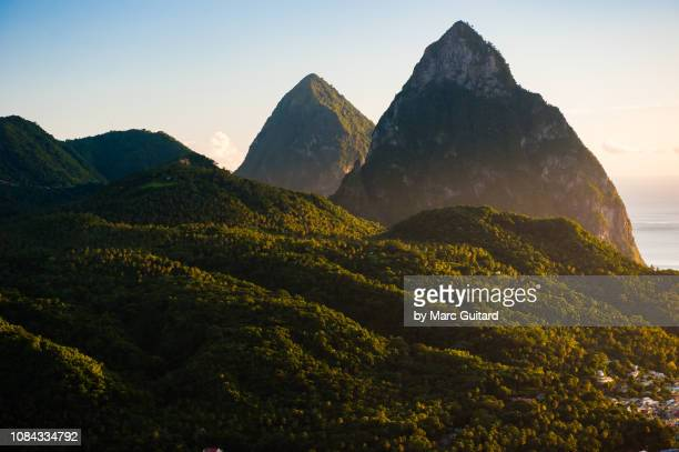 the pitons at sunset, saint lucia - st. lucia stock pictures, royalty-free photos & images