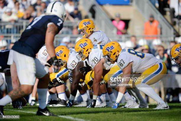 The Pitt offensive line gets set in their stances wearing throwback uniforms and throwback script Pitt helmets G Alex Officer T Brian ONeill and TE...
