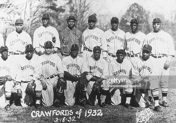 The Pittsburgh Crawfords of 1932 pose at their spring training site in Hot Springs, Arkansas in March. Satchel Paige is in the back row, second from...