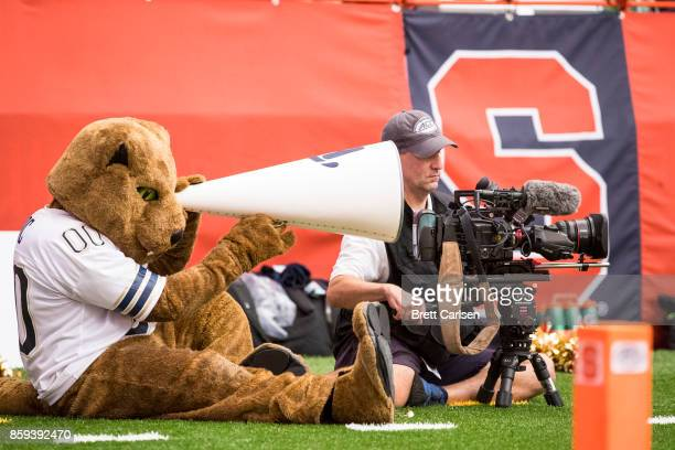 The Pittsburgh Panthers mascot mimics a cameraman during the game between the Syracuse Orange and the Pittsburgh Panthers at the Carrier Dome on...