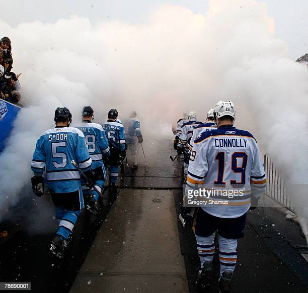 The Pittsburgh Penguins and Buffalo Sabres make their way down the runway at the start of the NHL Winter Classic on January 1, 2008 at Ralph Wilson...