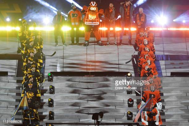 The Pittsburgh Penguins and Philadelphia Flyers are introduced during the 2019 Coors Light NHL Stadium Series at Lincoln Financial Field on February...
