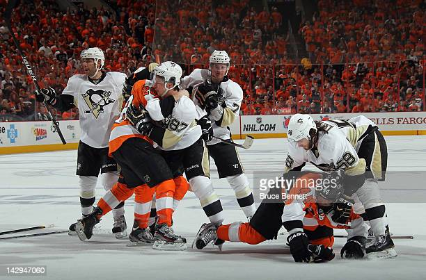 The Pittsburgh Penguins and the Philadelphia Flyers battle during the first period in Game Three of the Eastern Conference Quarterfinals during the...