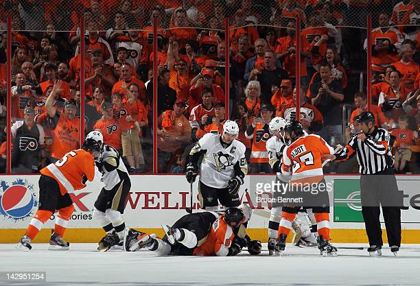 The Pittsburgh Penguins and the Philadelphia Flyers fight during the first period in Game Three of the Eastern Conference Quarterfinals during the...